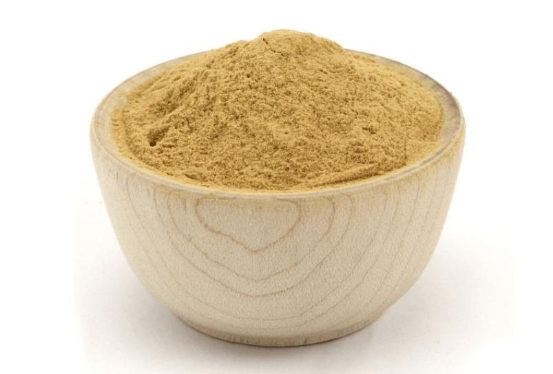 Wooden bowl of monk fruit powder