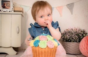 Balanced Eating: Baby with Cake with Flowered Icing