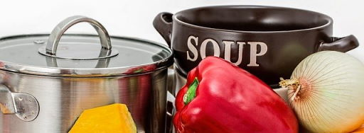 Soup pot, bowl and vegetables